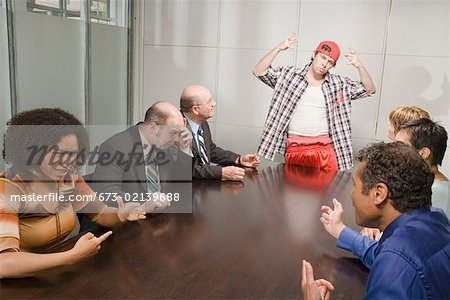 Weird co-worker at a meeting Stock Photo - Premium Royalty-Free, Image code: 673-02139688