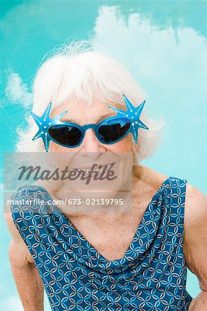 Woman wearing distinctive sunglasses Stock Photo - Premium Royalty-Free, Image code: 673-02139795