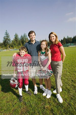 Football player and cheerleader with parents Stock Photo - Premium Royalty-Free, Image code: 673-02139996