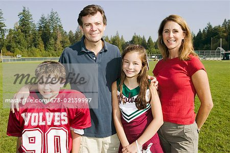 Football player and cheerleader with parents Stock Photo - Premium Royalty-Free, Image code: 673-02139997