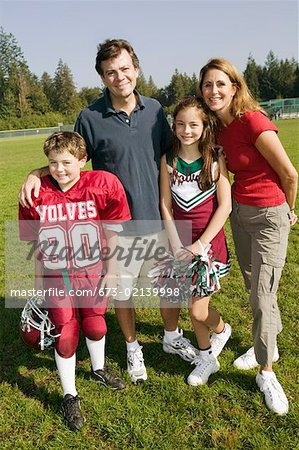 Football player and cheerleader with parents Stock Photo - Premium Royalty-Free, Image code: 673-02139998