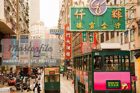 Trams and signs on busy Hong Kong street Stock Photo - Premium Royalty-Free, Image code: 673-02140640