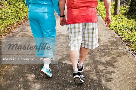 Couple walking together outside Stock Photo - Premium Royalty-Free, Image code: 673-02142552