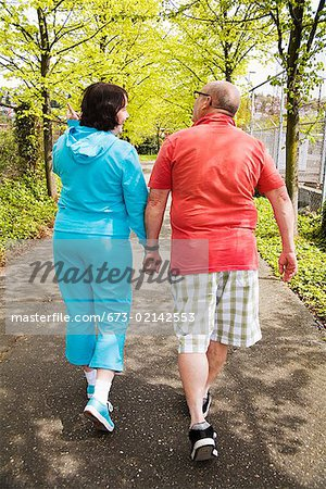Couple walking together outside Stock Photo - Premium Royalty-Free, Image code: 673-02142553