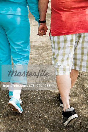 Couple walking together outside Stock Photo - Premium Royalty-Free, Image code: 673-02142554