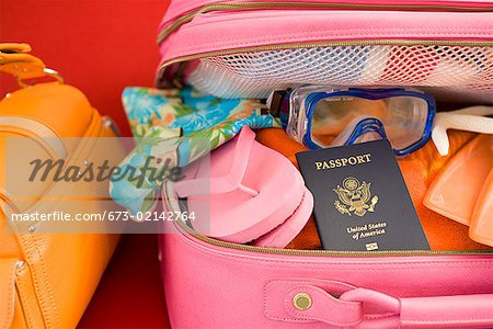 Packed suitcase Stock Photo - Premium Royalty-Free, Image code: 673-02142764