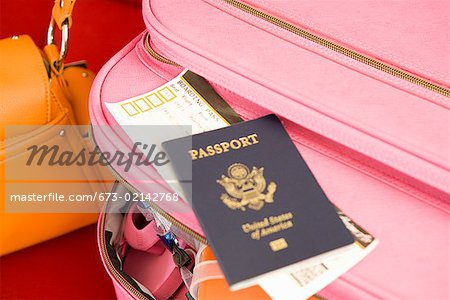 Passport on packed suitcase Stock Photo - Premium Royalty-Free, Image code: 673-02142768