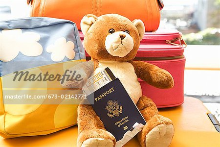 Teddy bear holding passport Stock Photo - Premium Royalty-Free, Image code: 673-02142771