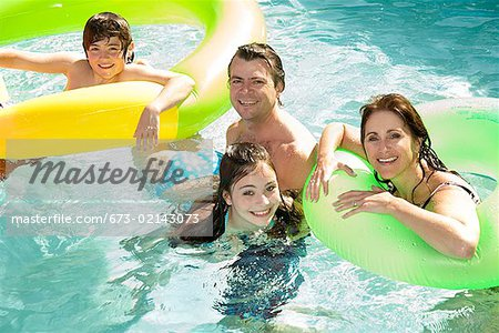 Family in swimming pool Stock Photo - Premium Royalty-Free, Image code: 673-02143073