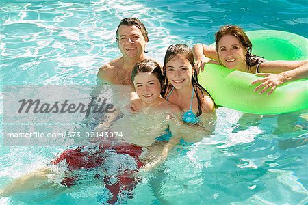 Family in swimming pool Stock Photo - Premium Royalty-Free, Image code: 673-02143074