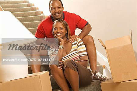 African couple next to moving boxes Stock Photo - Premium Royalty-Free, Image code: 673-02143125