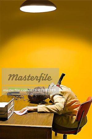 Deceased woman in office stabbed in the back Stock Photo - Premium Royalty-Free, Image code: 673-02801389