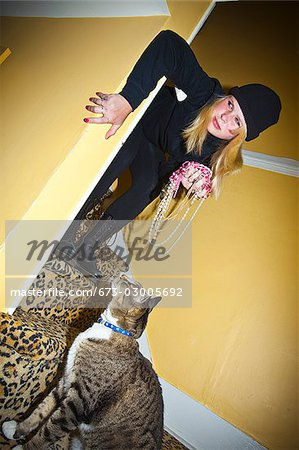 Teen girl dressed as cat burgler Stock Photo - Premium Royalty-Free, Image code: 673-03005692