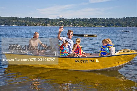 men and young children on motorboat ride Stock Photo - Premium Royalty-Free, Image code: 673-03405797