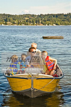 men and young children on motorboat ride Stock Photo - Premium Royalty-Free, Image code: 673-03405799