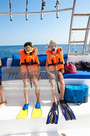 two children preparing to snorkle Stock Photo - Premium Royalty-Free, Image code: 673-03826264
