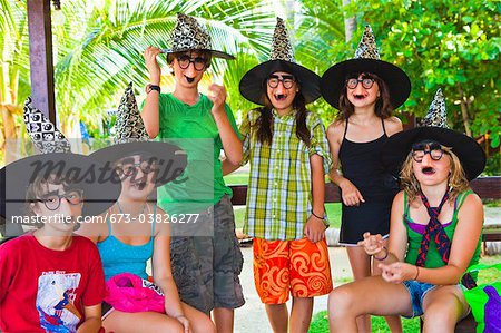 children in witch hats and masks Stock Photo - Premium Royalty-Free, Image code: 673-03826277
