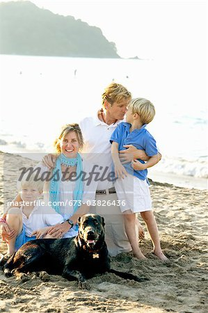 portrait of family on beach with dogs Stock Photo - Premium Royalty-Free, Image code: 673-03826436