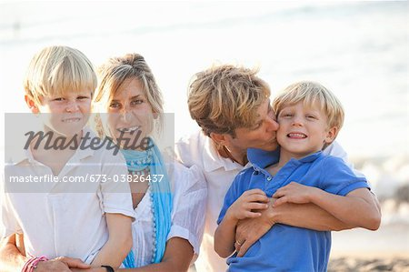 portrait of family on beach Stock Photo - Premium Royalty-Free, Image code: 673-03826437