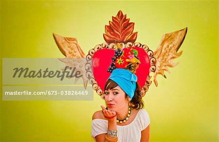 young woman wearing fruit hat Stock Photo - Premium Royalty-Free, Image code: 673-03826469
