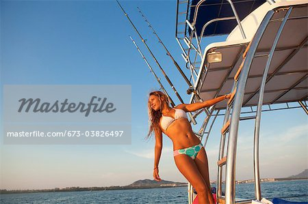 woman on ladder of yacht Stock Photo - Premium Royalty-Free, Image code: 673-03826497
