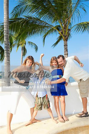 family posing as superheroes Stock Photo - Premium Royalty-Free, Image code: 673-03826504