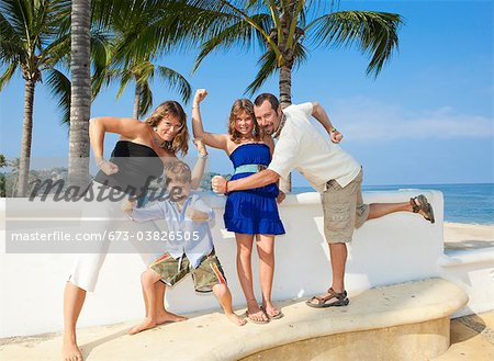 family posing as superheroes Stock Photo - Premium Royalty-Free, Image code: 673-03826505
