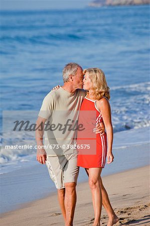 middle aged couple hugging on beach Stock Photo - Premium Royalty-Free, Image code: 673-03826575