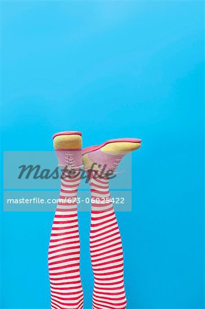 Legs in striped socks with colorful shoes Stock Photo - Premium Royalty-Free, Image code: 673-06025422