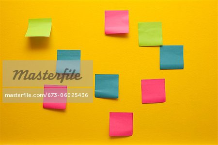 Yellow wall with colorful post-its Stock Photo - Premium Royalty-Free, Image code: 673-06025436