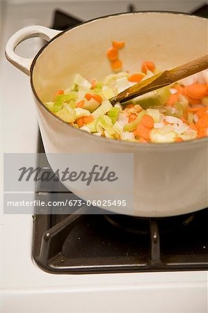 White pot with vegetables on stove Stock Photo - Premium Royalty-Free, Image code: 673-06025495