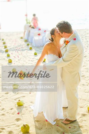 Bridal couple kissing on beach Stock Photo - Premium Royalty-Free, Image code: 673-06025622