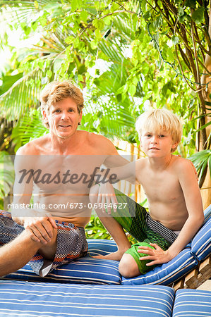 Man and boy sitting outdoors Stock Photo - Premium Royalty-Free, Image code: 673-06964627