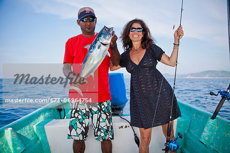 Man and woman on charter fishing boat Stock Photo - Premium Royalty-Free, Image code: 673-06964754