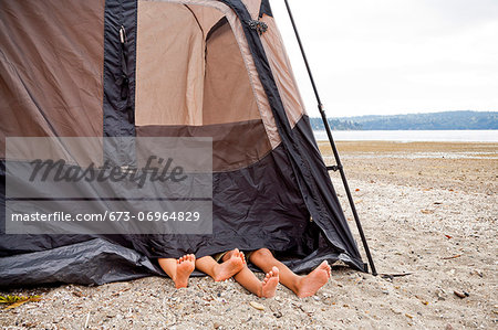 Children playing in tent on beach Stock Photo - Premium Royalty-Free, Image code: 673-06964829