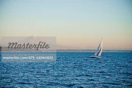 Mt. rainier behind sail boat on puget sound Stock Photo - Premium Royalty-Free, Image code: 673-06964834
