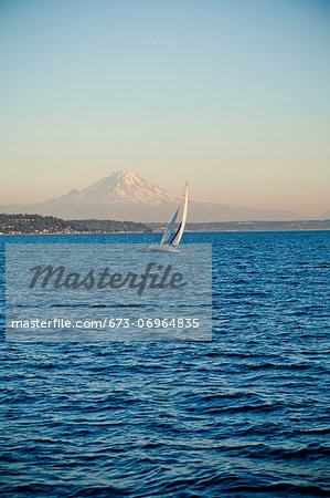 Mt. Rainier behind sail boat on Puget Sound Stock Photo - Premium Royalty-Free, Image code: 673-06964835