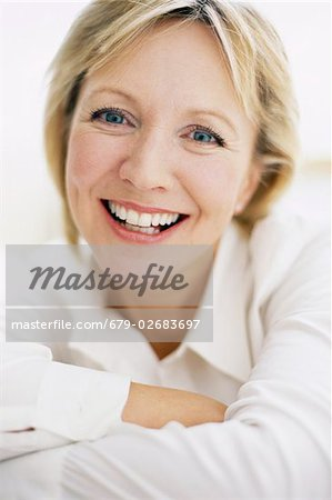 Smiling woman. Happy 48 year old woman. Stock Photo - Premium Royalty-Free, Image code: 679-02683697
