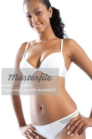 Smiling woman in her underwear. Stock Photo - Premium Royalty-Free, Image code: 679-02685573