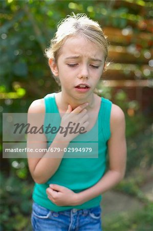 Girl coughing Stock Photo - Premium Royalty-Free, Image code: 679-02994979