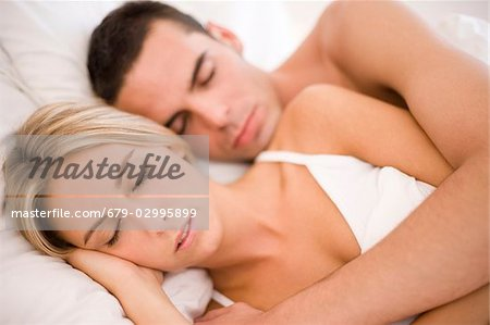 Couple in bed Stock Photo - Premium Royalty-Free, Image code: 679-02995899