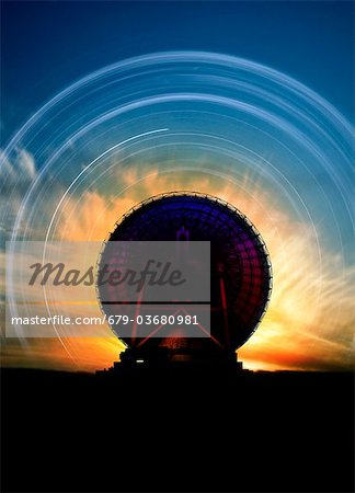 Radio telescope and star trails, computer artwork. Stock Photo - Premium Royalty-Free, Image code: 679-03680981