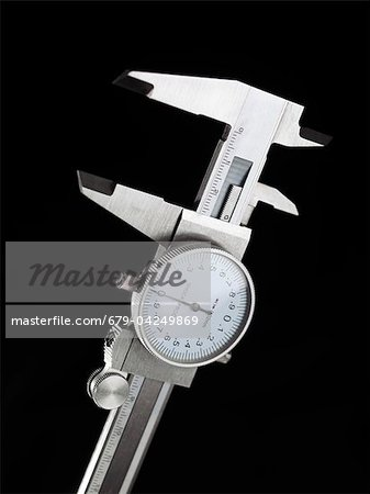 Dial calipers Stock Photo - Premium Royalty-Free, Image code: 679-04249869