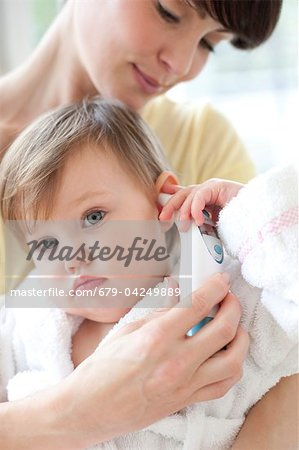 Taking a toddler's temperature Stock Photo - Premium Royalty-Free, Image code: 679-04249889