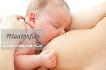 Newborn baby breastfeeding Stock Photo - Premium Royalty-Free, Image code: 679-05797318