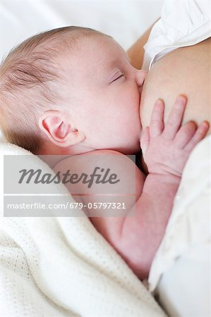 Newborn baby breastfeeding Stock Photo - Premium Royalty-Free, Image code: 679-05797321