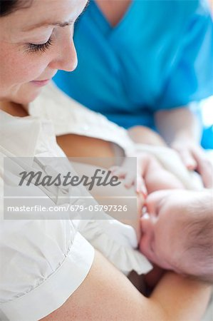 Newborn baby breastfeeding Stock Photo - Premium Royalty-Free, Image code: 679-05797326