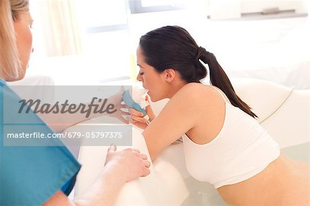 Water birth Stock Photo - Premium Royalty-Free, Image code: 679-05797375