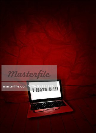 Cyber bullying, conceptual computer artwork. Stock Photo - Premium Royalty-Free, Image code: 679-05996296