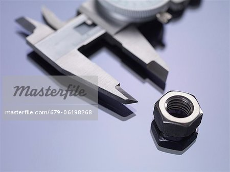 vernier calipers measuring a nut. Stock Photo - Premium Royalty-Free, Image code: 679-06198268